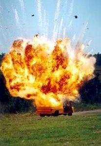 1,000 lbs of ANFO plus added incendiaries loaded in the back of a pick up truck in Shreveport, LA by LA 'Special Forces' State Military - (Branch of the Guard?).  Note: Explosive gases take the path of least resistance with virtually no damage under the truck, let alone a 'crater'.  The video that accompanied this picture did not survive cleansing and censorship.